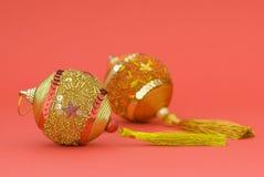 Christmas decoration. Tho balls on pink background Royalty Free Stock Photo