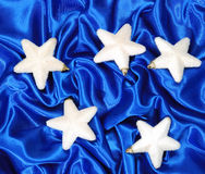 Christmas decoration. On blue sateen with big stars Royalty Free Stock Image