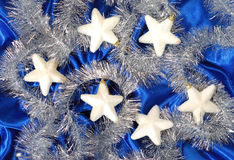 Christmas decoration. On blue sateen with big stars on tinsel Stock Images