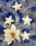 Christmas decoration. On blue sateen with big stars on tinsel royalty free stock photography