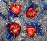 Christmas decoration. Blue sateen with four hearts decoration Royalty Free Stock Photography