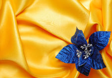Christmas decoration. On golden sateen with blue  flower Stock Photos