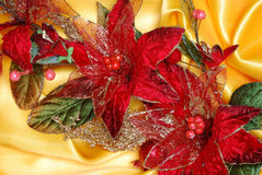 Christmas decoration. On golden sateen with  flowers Royalty Free Stock Photography