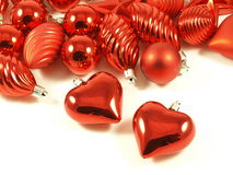 Christmas decoration. Christmas decoration: hearts and crystal red balls on isolated white background Stock Images