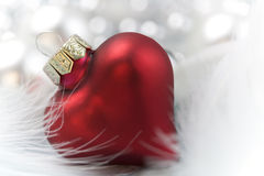 Christmas decoration. Christmas heart on white feather Stock Photos