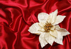 Christmas decoration. On red sateen with white flower royalty free stock photo