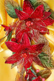 Christmas decoration. On golden sateen with flowers Royalty Free Stock Images