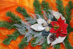 Christmas decoration. On golden sateen with flowers Royalty Free Stock Photo