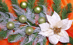 Christmas decoration. On golden sateen with flowers Stock Photos