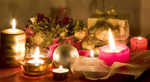 Christmas decoration. Christmas gift, balls and candles Royalty Free Stock Photos