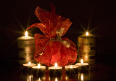 Christmas decoration. Close up on christmas candles and gift Royalty Free Stock Photo