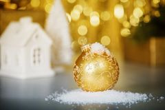 Christmas decoration on abstract gold background, close up stock photography