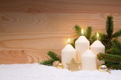 White burning Candles for the third advent. Third Advent. Christmas decoration for advent three candles burning. White burning Candles for the third advent Royalty Free Stock Image