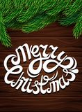 Christmas decoration against the dark wooden planks. Christmas tree branches letter inscription wooden background. Poster for the New Year and Christmas Stock Images