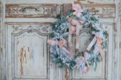 Christmas decoration on ancient vintage old commode chest of drawers. Stock Images