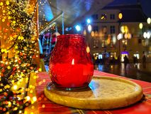 Free Christmas Decoration And Red Candle Red Glass Cup On Market Place Kiosk Top In Tallinn Old Town City Night Blurred Light People Wa Stock Photography - 167192972