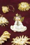 Christmas Decoration Angel Figurine. Christmas Decoration Angel on a purple fabric background Royalty Free Stock Photos