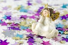 Christmas Decoration Angel Figurine. Arranged with shiny stars Stock Images