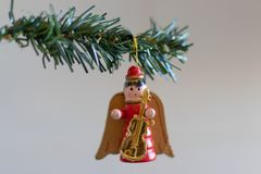 Christmas decoration. Angel with a guitar hanging on a green Christmas tree branch. stock photography