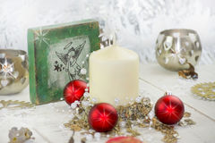 Christmas decoration with angel. Christmas table decoration with candle hearts Royalty Free Stock Image