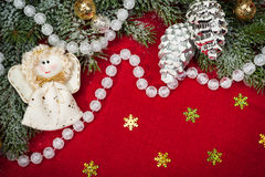 Christmas decoration and angel toy on red Stock Images