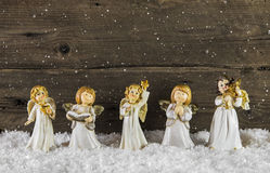 Christmas decoration with angels on wooden background for a gree Stock Photos