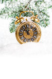 Christmas decoration - antique golden clock. Vintage christmas decoration - antique golden clock and fir-tree in snow. with copy space, on white background Royalty Free Stock Image