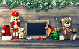 Christmas decoration with antique toys and blackboard Stock Photos
