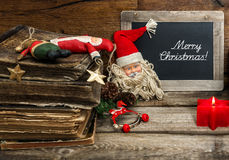 Christmas decoration with antique toys and red candle Royalty Free Stock Photography