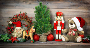 Christmas decoration with antique toys teddy bear Stock Photos