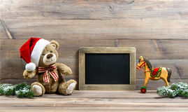 Christmas decoration with antique toys teddy bear and rocking ho