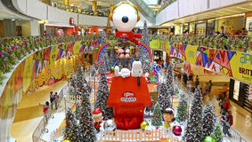 Christmas decoration at apm shopping mall, hong kong. Huge display of snoopy the beagle and decorative ornaments covered christmas trees at the apm shopping mall royalty free stock images
