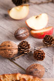 Christmas decoration with apples,cone and walnuts Stock Photo