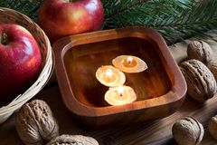 Free Christmas Decoration - Apples, Pine Branches, Walnuts And Floating Candles In A Bowl Stock Photography - 104196432