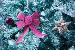Christmas decoration on the artificial snowy Christmas tree Royalty Free Stock Images