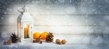 Christmas decoration background with a candle light lantern, tan royalty free stock image