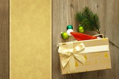 Christmas decoration background with a gift on wooden background royalty free stock photo