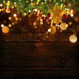 Christmas decoration background with golden stars and christmas ornaments. Free space for your text Stock Photography