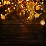 Christmas decoration background with golden stars and christmas ornaments. Free space for your text Royalty Free Stock Photography