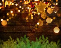 Christmas decoration background with golden stars and christmas ornaments. Free space for your text Stock Image