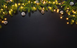 Christmas decoration background over black chalkboard. Top view. Horizontal photo of decorations taken from above with copy space for text and other web or royalty free stock photography