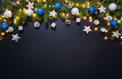 Christmas decoration background over black chalkboard Stock Photos