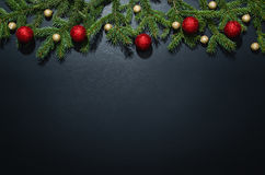 Christmas decoration background over black chalkboard. Top view. Horizontal photo of decorations taken from above with copy space for text and other web or royalty free stock photos