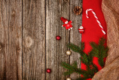Christmas decoration background over wooden table with red and linen cloth. Royalty Free Stock Images