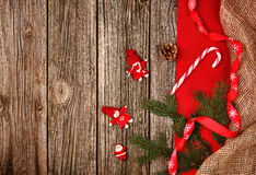 Christmas decoration background over wooden table with red and linen cloth. Royalty Free Stock Photos