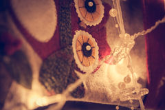 Christmas decoration background with owl application in warm light from garland lights in christmas eve Royalty Free Stock Photo