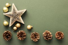 Christmas decoration background with pine cones and a star stock photo