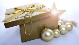 Christmas decoration. Christmas background with present and christmas bulbs Stock Photos