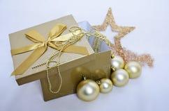 Christmas decoration. Christmas background with present and christmas bulbs Stock Image