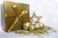 Christmas decoration. Christmas background with present and christmas bulbs Royalty Free Stock Image